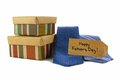 Happy fathers gifts day tag with gift boxes and ties over white Stock Images