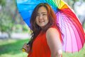 Happy fatty woman with umbrella asian outdoor in a park Stock Images