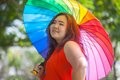 Happy fatty woman with umbrella asian outdoor in a park Stock Photo