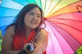 Happy fatty woman with umbrella asian outdoor in a park Royalty Free Stock Image