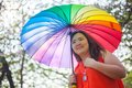 Happy fatty woman with umbrella asian outdoor in a park Royalty Free Stock Photo