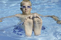 Happy feet summertime relaxation in the pool Royalty Free Stock Photography