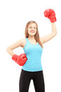 Happy female athlete wearing boxing gloves and gesturing triumph isolated against white background Stock Photography