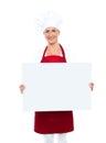 Happy female chef displaying white billboard Stock Image