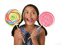 Happy female child holding two big lollipop in crazy funny face expression in sugar addiction Royalty Free Stock Photo