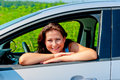 Happy female driver in her new car Royalty Free Stock Images