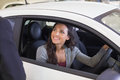 Happy female driver at the wheel sitting in her car new showroom Royalty Free Stock Image