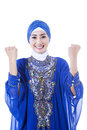 Happy female muslim in blue dress isolated on white background Stock Photo
