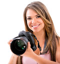 Happy female photographer with a camera isolated over white Royalty Free Stock Photography