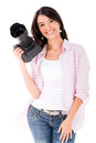 Happy female photographer holding camera isolated over white Stock Photo