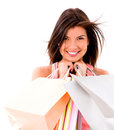 Happy female shopper holding bags isolated over white Royalty Free Stock Images