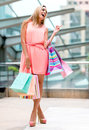Happy female shopper holding bags and smiling Royalty Free Stock Images