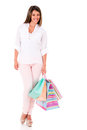 Happy female shopper holding hsopping bags isolated over a white background Stock Photography