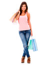 Happy female shopper holding shopping bags isolated over white Stock Photography