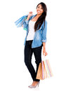 Happy female shopper holding shopping bags isolated over white Royalty Free Stock Images