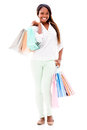 Happy female shopper holding shopping bags isolated over white background Royalty Free Stock Images