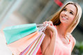 Happy female shopper holding shopping bags and smiling Stock Image