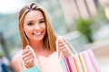 Happy female shopper holding shopping bags and smiling Royalty Free Stock Image