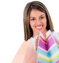Happy female shopper with shopping bags isolated over white Stock Images