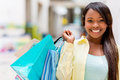 Happy female shopper at the shopping center smiling Stock Images