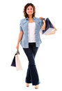 Happy female shopper walking with shopping bags isolated over white Stock Images