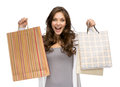 Happy female with shopping bags half length portrait of isolated on white concept of consumerism and purchase Stock Photo