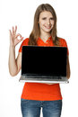 Happy female showing a laptop screen and gesturing OK Royalty Free Stock Photography