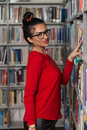 Happy Female Student With Book In Library Royalty Free Stock Photo