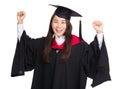 Happy female student celebrating graduation isolated on white Royalty Free Stock Photos