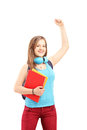 Happy female student gesturing happiness with raised hands isolated on white background Stock Photos