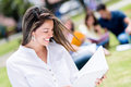 Happy female student holding a notebook outdoors Royalty Free Stock Image