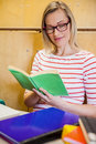 Happy female student reading a book at the university Royalty Free Stock Images