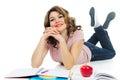 Happy female student studying on floor isolated on white background Royalty Free Stock Image