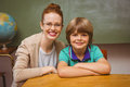 Happy female teacher and little boy in classroom Royalty Free Stock Photo
