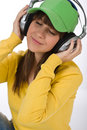 Happy female teenager enjoy music Stock Images
