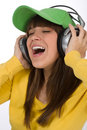 Happy female teenager enjoy music with headphones Stock Photo