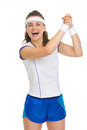 Happy female tennis player rejoicing success Stock Image