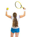 Happy female tennis player rejoicing success rear view Stock Photos
