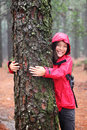 Happy female tree hugger Royalty Free Stock Photo