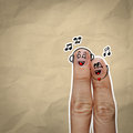 The happy finger couple in love with painted smiley and sing a s