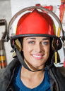 Happy firewoman at fire station closeup portrait of Royalty Free Stock Images