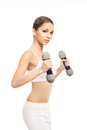 A happy and fit woman holding dumbbells young sporty beautiful girl with the isolated on white Stock Images