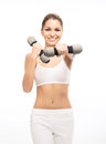 A happy and fit woman holding dumbbells young sporty beautiful girl with the isolated on white Royalty Free Stock Photo