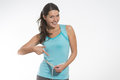 Happy fit young woman measuring her waistline caucasian after diet on gray background Royalty Free Stock Photography