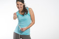 Happy fit young woman measuring her waistline caucasian after diet on gray background Stock Photo