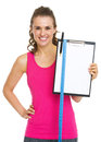 Happy fitness trainer showing blank clipboard with measure tape isolated on white Royalty Free Stock Photography