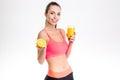 Happy fitness woman holding half of orange and juice Royalty Free Stock Photo