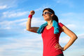 Happy fitness woman success in sport successful raising arm with energy and fist to the sky after running and exercising goals and Stock Photo