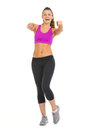 Happy fitness young woman pointing in camera isolated on white Royalty Free Stock Photography