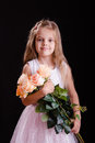Happy five year old girl with a bouquet of flowers Royalty Free Stock Photo